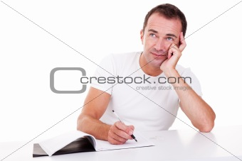 Portrait of a middle-age man thinking and writing, looking up, isolated on white. Studio shot
