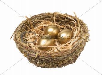 Three golden hen's eggs in the bird's nest isolated on white