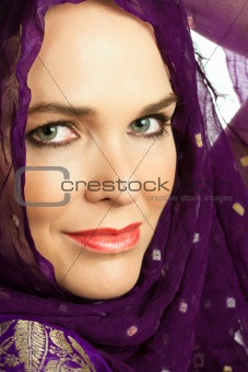 Closeup portrait of a beautiful Indian woman wearing a head scar