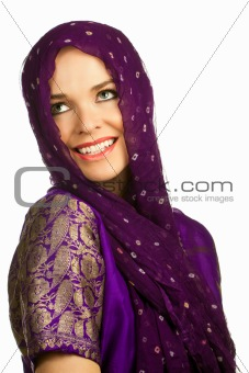 Beautiful indian woman in traditional clothing and head scarf