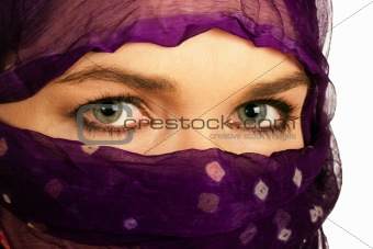 Beautiful Indian or Asian woman wearing a purple veil