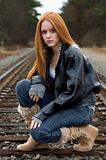 Girl crouching on tracks