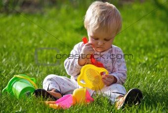 Baby girl play on grass