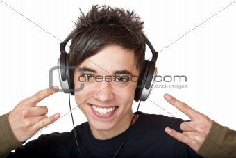 Male Teenager listening to music and smiles happy