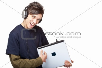 Teenager with headphones plays guitar on laptop