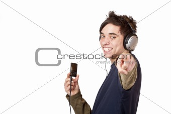 Teenager with headphones and mp3 player points with finger
