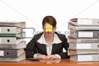 business woman in office between folder stacks needs help