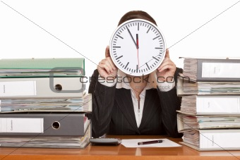 Woman in office has stress because of time pressure