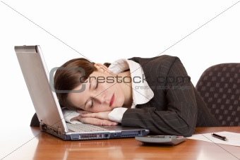 Tired overworked business woman sleeps in office on laptop