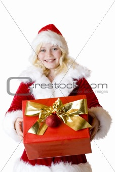 Young girl with christmas present smiles happy