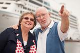 Senior Couple On Shore in Front of Cruise Ship While on Vacation.