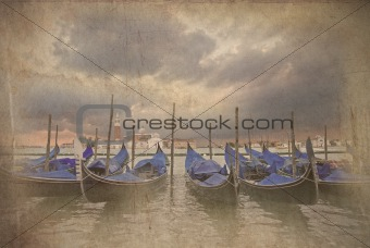 Retro grunge photo of Gondolas bobbing in lagoon outside San Mar