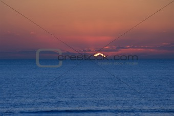 Beautiful minimal landscape seascape of stunning sunset over cal
