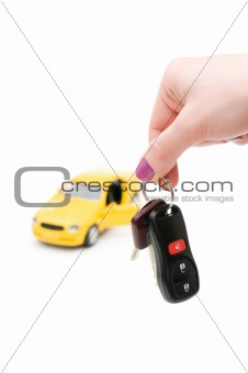Car keys and car at background isolated on white