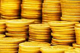 Close up of gold coin stacks - shallow DOF