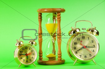 Time concept with clock and hour glass