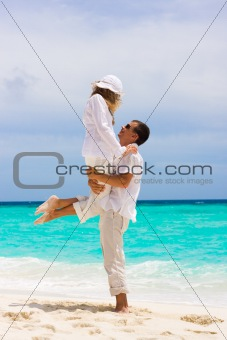 Happy young couple on a beach