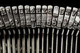 Close-up of typewriter letter and symbol keys
