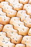 Shaped browned crisp biscuits as tile background