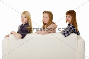 Three young girls - classmate on couch