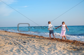 kids walking along the beach together