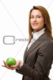 Business woman holding green apple.