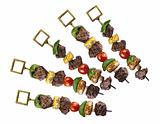pork shish kebab with vegetables isolated on white