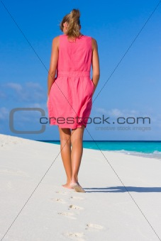 A young woman on a tropical beach