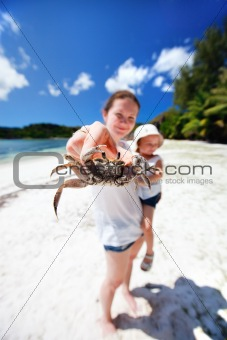 Mother holding crab