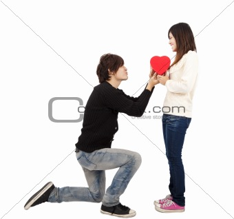 Asian young Man handing over love gift  to  young woman on Valentine Day