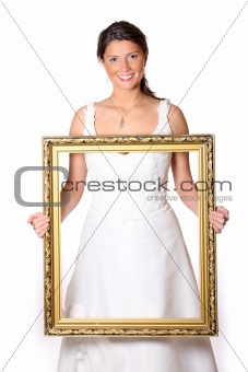Beautiful bride with gold frame