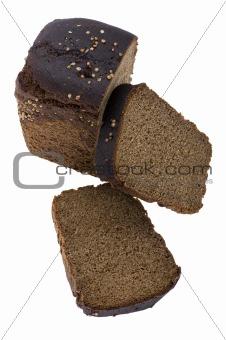 Cutting black bread close up