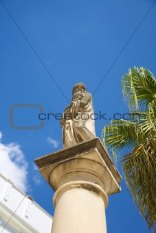 ancient statue over column