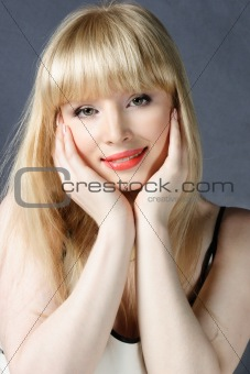 Attractive woman with hands on cheeks