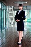 Fullbody business woman smiling and stand in morden office