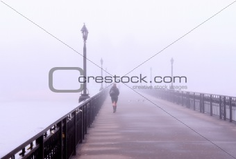 A lonely lady crossing a bridge