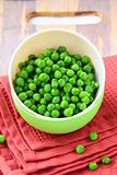 fresh green peas in a cup