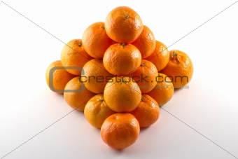 Clementines arranged in a pyramid shape
