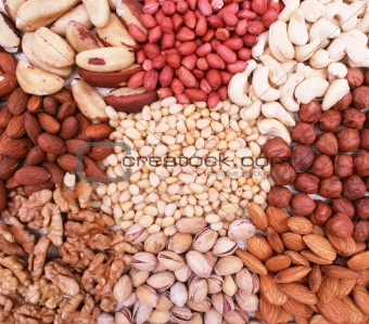 Assorted nuts on natural sackcloth as background