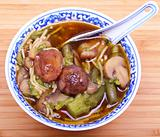 Vegetarian chinese soup with noodles and mushrooms