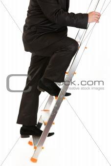 Businessman climbing upwards upon ladder.  Close-up.