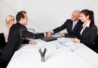 Business people closing the deal