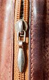 zipper on brown leather