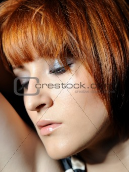 Beautiful woman face with natural make-up relaxing
