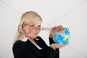 Beautiful business woman in a suit with globe figure