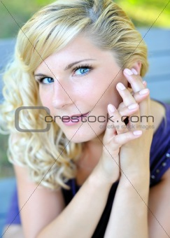 Beautiful young woman with fashion hairstyle outdoors in summer