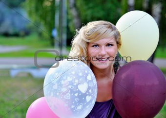 Beautiful young woman with fashion haitstyle with baloons