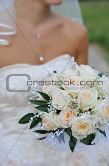 beautiful wedding flower bouquet in the hands of bride