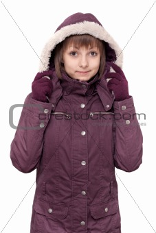 Girl in winter violet hooded jacket