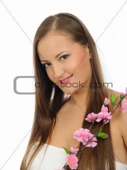 Beautiful woman with long healthy hair and natural make-up